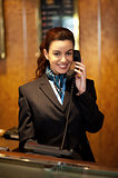 Stylish female attendant at hotel reception