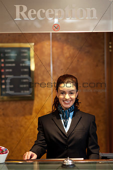 Charming pretty receptionist posing