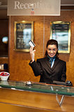 Beautiful receptionist posing with customers cash card