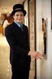 Profile shot of a doorman in bowler hat