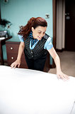 Housekeeping executive making the bed ready