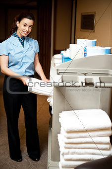 Housekeeping in charge pulling out the bath towel