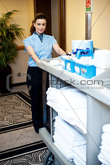 Beautiful Employee Pushing Housekeeping Cart