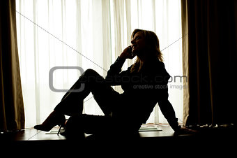 Corporate woman posing in style while communicating