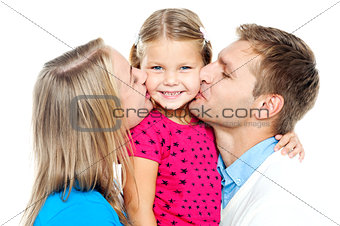 Mom and dad kissing their beautiful kid
