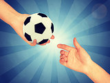 Soccer ball in hand
