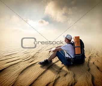 Tourist in sand desert