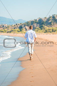a gentle stroll along the beach barefoot