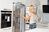 commercial cute girl in front of refrigerator