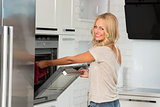 girl cook with oven with great smile