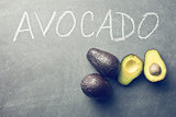 halved avocado on blackboard