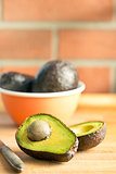 halved avocado on kitchen table
