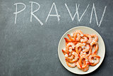 prawns on chalkboard