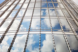 View of clouds reflected the glass surface of Burj Khalifa, Dubai, the tallest tower in the world