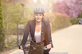 Businesswoman Biking at the Street with Helmet