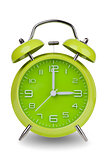 Green alarm clock with hands at 3 am or pm