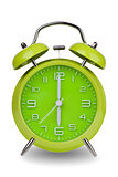 Green alarm clock with hands at 6 am or pm