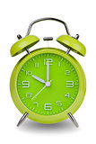 Green alarm clock with hands at 10 am or pm