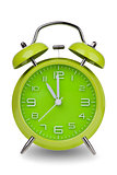 Green alarm clock with hands at 11 am or pm