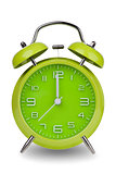 Green alarm clock with hands at 12 am or pm