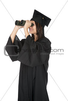Beautiful Caucasian woman wearing in a black graduation gown