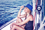 Relaxed girl on sailboat