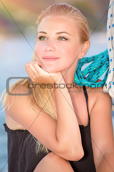Beautiful woman on the sailboat