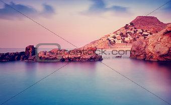 Greek island in purple sunset