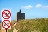 warning signs for surfers at ballybunion castle on the wild atlantic way in ireland