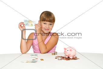 Little  girl with money in hands  isolated
