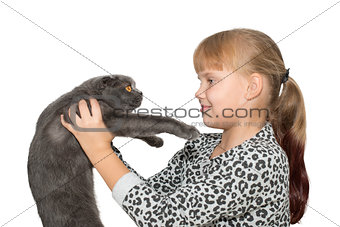 Portrait of little girl with  cat isolated