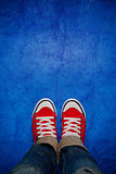 Feet From Above, Teenager in Sneakers Standing on Blue Backgroun