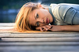 Fashion portrait of strict red-haired girl,