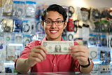 Happy Chinese Man Showing First Dollar Earning In PC Shop