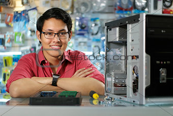 Portrait Of Chinese Man With PC In Computer Shop