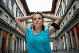 Thoughtful fitness woman near uffizi gallery in florence, italy