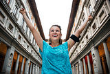 Happy fitness woman rejoicing near uffizi gallery in florence, i