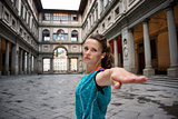 Fitness woman workout near uffizi gallery in florence, italy