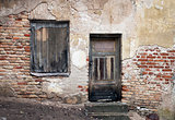 Old window and door with cracked wall