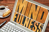 mindfulness word typography on laptop