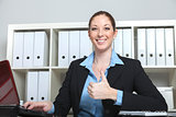 Businesswoman holds thumb up