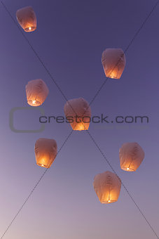 Sky lanterns flying upwards