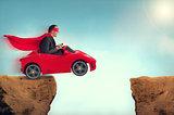 man in a car jumping a ravine