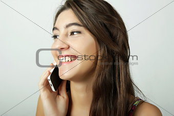 Attractive latin woman talking on mobile phone
