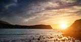 Stunning vibrant sunrise landscape over Lulworth Cove Jurassic Coast, England