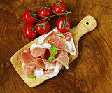 parma ham (jamon) with fragrant herbs traditional Italian meat appetizer