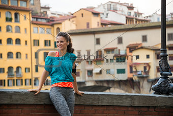 Fitness woman standing near ponte vecchio in florence, italy