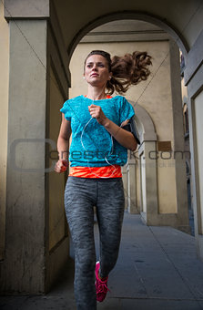 Fitness woman jogging outdoors in the city