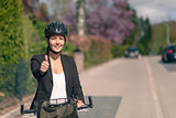 Active Businesswoman on her Bike Showing Thumbs up
