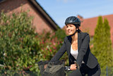 Businesswoman on Bicycle Going to her Office